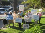 Opponents to the village entrance proposal protested outside and inside City Hall during last week's City Council meeting.
