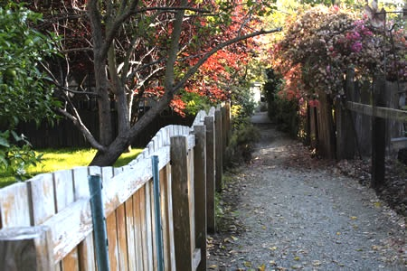 ....includes gravel footpaths between homes rather than streets or sidewalks.