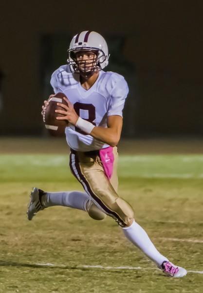 Quarterback Jake Simon rolls out to throw.  Simon is on track to be Laguna's leading sophomore quarterback.  Simon has thrown for 697 yards on 90 attempts on the season. Photos by Doug Landrum.