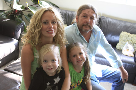 Shayne Monahan, right, with his wife Amy Denes and her girls, Brooklyn and Sky Denes, in a Club Laguna apartment they say is making them sick. Photo by Andrea Adelson