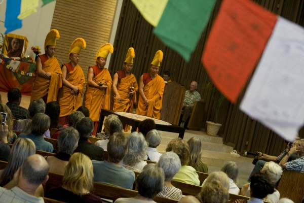 An earlier group of Tibetan monks in the Congregational Church sanctuary and the mandala they created. Photo by Ted Reckas.