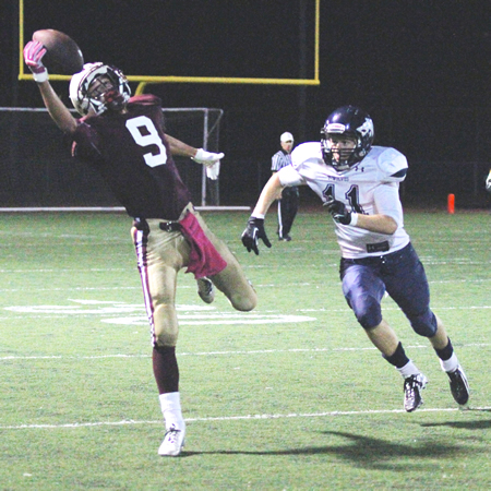 Senior wide receiver Sean Hampton makes a one-handed grab against Northwood, one of a team high five catches for 85 yards he made on the night. Photo by Dante Fornaro