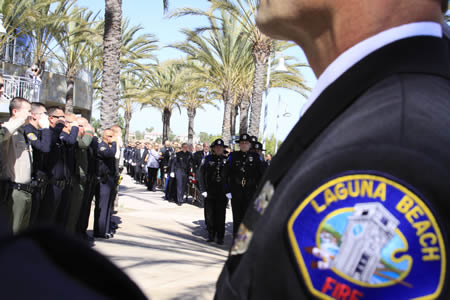 Laguna's police force escorting the casket of Jon Coutchie at a memorial service last Friday, Sept. 27.