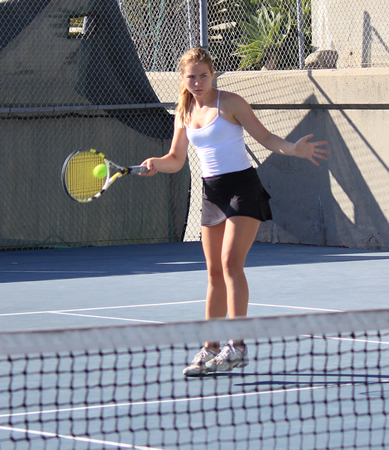 Freshman Malia Helms and doubles partner Stephanie Tat won all three of their sets, helping the Breakers beat Costa Mesa 17-1on Laguna's home courts Tuesday, Oct. 8. Photo by Robert Campbell.