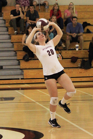 Sophomore Taylor Cunningham sets the ball against Estancia during an Orange Coast League match at Dugger Gym on Tuesday, Oct. 8. Photo by Robert Campbell.