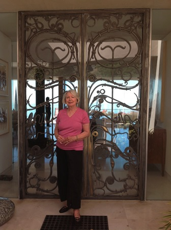 Sandra LeWinter outside her museum-inspired gates.