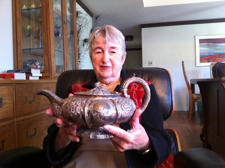 Helen Paxson with the only memento she has from her mother's Skyline Drive home.  Photo by Sean Orfila.
