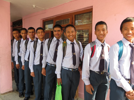 Children from Chhahari en route to their nearby school in Nepal. Supporters plan a fundraiser on Sunday.
