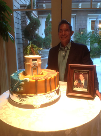 Laguna Nursery owner Ruben Flores with a Main Beach-themed cake and tribute to council founder Harry Lawrence
