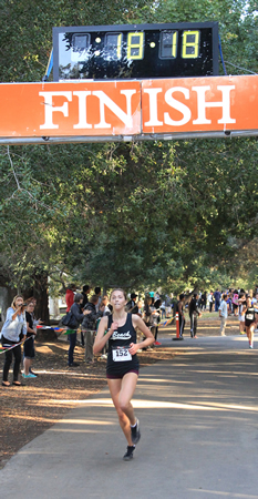 Laguna Beach junior Natalie Kimball steps across the line as Orange Coast League's champ. Photos by Robert Campbell