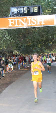 Senior Veda Rebollar wins the Orange Coast League championship, shaving 36 seconds off his personal best.