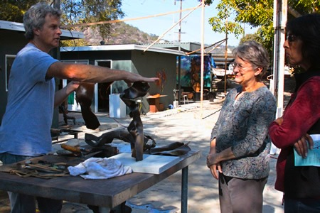 Sculptor Louis Longi describing his methods to visitors in his outdoor studio last year; polls show the scale of his proposed project.