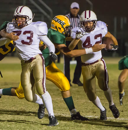 Led by Karl Von Schrimpf, Josh French ran for five tough yards in the second quarter.