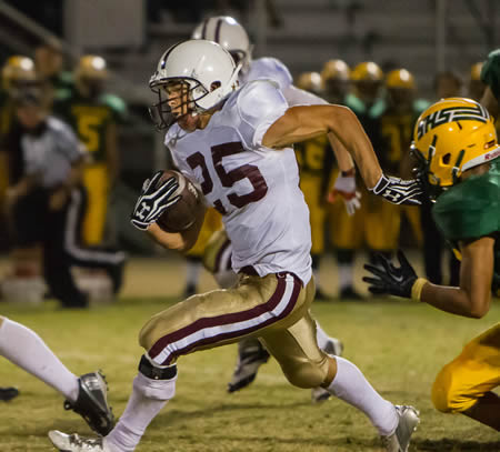 Nathan Lancaster scored five of Laguna's eight touchdowns against Saddleback.  Lancaster gained 335 yards on 18 carries against the Roadrunners