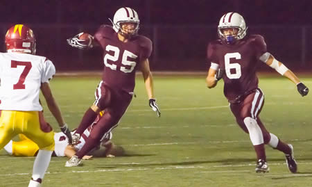 Andres DeLaRosa leads Nathan Lancaster through a gaping hole punched in the Eagles' defense.  The one-two punch of Lancaster and DeLaRosa helped Laguna rush for 515 yards against Estancia, third highest total in school history.