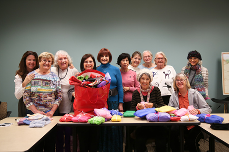 Needle Arts Guild members, from left, Dona Harman, Mary Lewis, Maria Martini, Jean Arovas, Adrienne Sheinwald, Olga Whitcomb Mary Alderson, Maureen Buffington (seated) Yves Newman, June Ann Pribram, Roberta Luque (seated), and Diane McPherson.