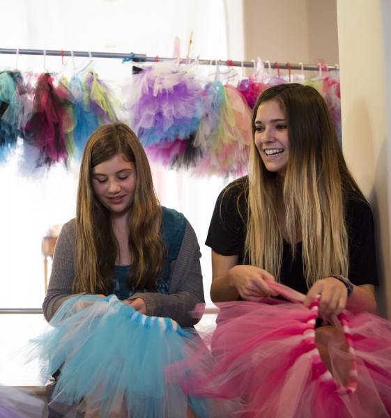 From left, Lauren Ward and Kaylie Monahan making tutus for Kostumes 4 Kids.