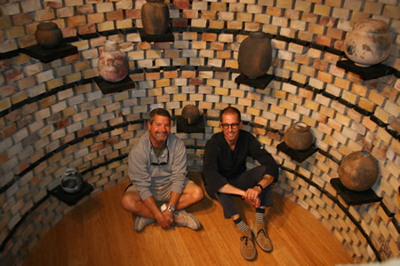 Mason Mike Hilburn, left, created an unusual museum installation for ceramicist Adam Silverman's work. Photo by Robin Pierson