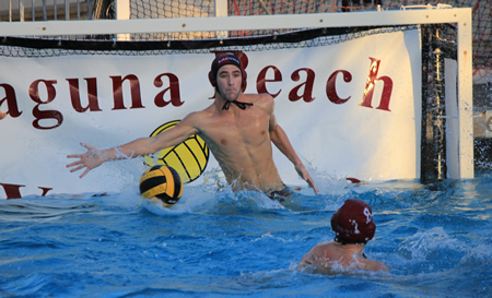 Junior Garret Hartley reaches for one of his seven saves in Laguna's second round CIF win against Villa Park.