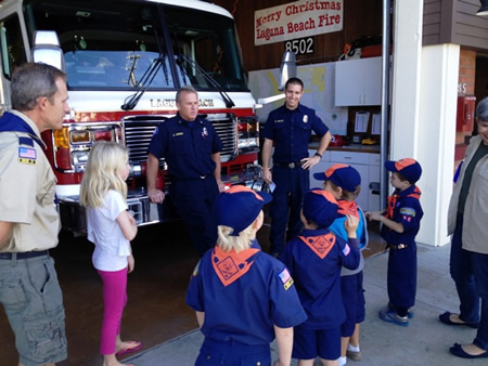Scouts learn the ropes from a firefighter.
