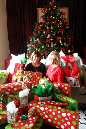 Ebell Club members Amy Altieri and Penny Stasny amid gifts wrapped for two families adopted by the organization, one of the ways the town's oldest philanthropy supports the town community. The club welcomes new members committed to combining friendship, fundraising and fun. Information email President Carla White at president@ebelllagunabeach.org, or call (949) 315-9578.