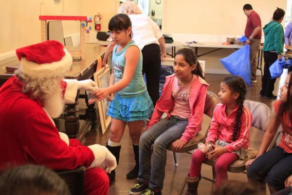 Santa Claus, who looks a lot like Brian Sadler, hands out treats.