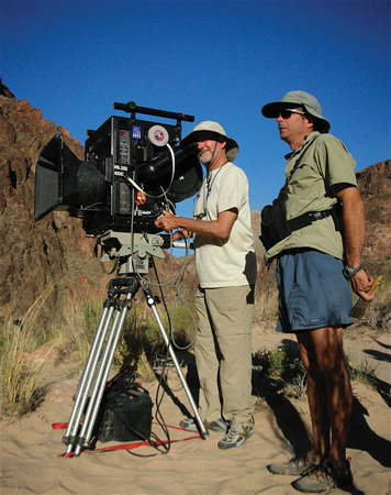 Greg MacGillivray, left, filming on location.