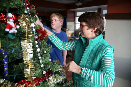 Glennwod House residents Carter Bak and Tina Cassani deck the halls for the first Christmas in their new home.