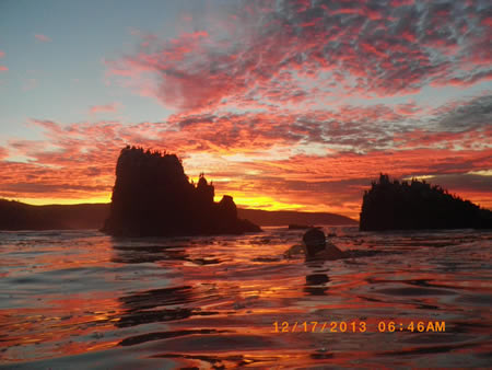 Photo by Howard Burns.  Patsee Ober's ocean swimming group set out at 6 a.m. from Shaws Cove in the pre-dawn darkness and stroked into a spectacular sunrise this week.