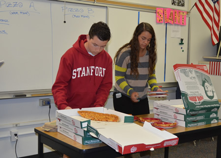 LBHS students Daniel West and Brooke Michaels prepare samples for a student taste test.