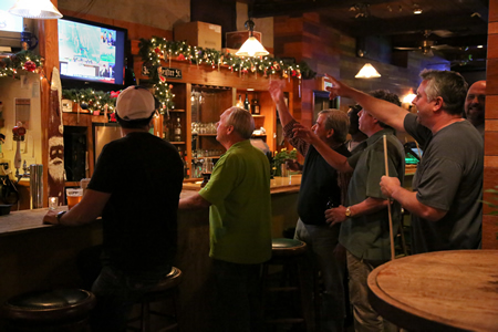 College football fans at Laguna Beach's Marine Room Tavern react to the BCS game played this past Monday at the Rose Bowl. Photo by Jody Tiongco