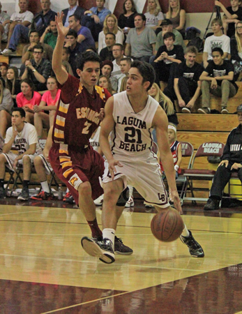 Photo by Robert Campbell Senior Matt Jones drives the baseline against an Estancia defender during Laguna's 53-47 home win on Friday, Jan. 17.