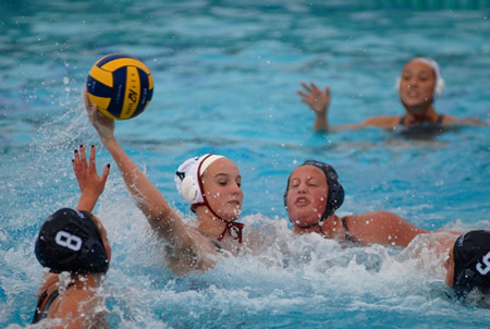 Makenzie Fischer, who had four goals, four assists and four steals to lead top-ranked Laguna to a 13-1 victory at Newport Harbor, gets by Newport players Heidi Fults, Christina O'Beck and Kate Pipken