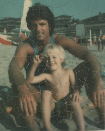 Ricky Nelson and his son Matthew on the sand near the family home near Victoria Beach.