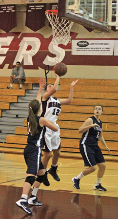 Sophomore Jackie Cenan drives for two of her 16 points in a 52-38 home win against St. Margaret's on Friday, Jan. 10. Credit: Robert Campbell