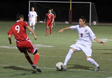 Sophomore Edward Willette uses some fancy footwork against an Estancia defender during Laguna's 1-0 home loss on Friday, Jan. 17.