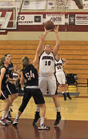 : Senior center Jane Wallin goes for two of her 11 points against St. Margaret's on Friday, Jan. 10.
