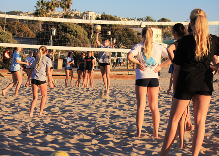 Girls line up to show off their skills in hopes of making Laguna Beach High's first beach volleyball team.