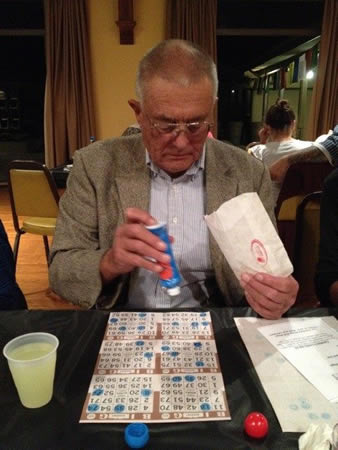 Al Gump prepares his bingo chips for a game at the Congregational Church.