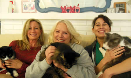 From left, volunteer Pam Knudsen, volunteer; assistant director Annie Pastorkovich, and care-taker Stephanie Farrell with some of their charges, Precious, Smokey and Sammy.