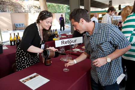 A visitor samples the wares at last year's food and wine festival on the Festival of Arts' grounds.
