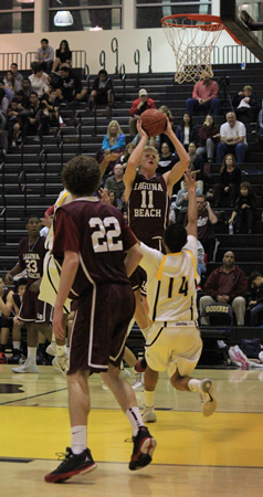 : Senior Alec Wulff goes up for two of his eight points in Laguna's 44-29 road win against Godinez on Friday, Jan. 24.