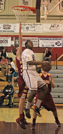 Senior Josh Adams works hard in the paint for two of his 11 points in Laguna's 53-47 home win against Estancia on Friday, Jan. 17.