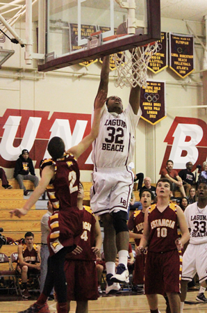 Junior Noah Blanton slams home two of his 11 points in Laguna's 53-47 home win against Estancia on Friday, Jan. 17.