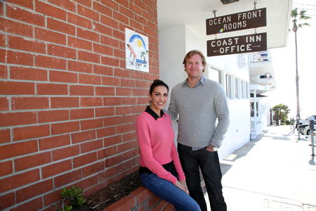 Chris Dornin and his wife, Marcella Kaytie-Dornin outside their newest project, the historic Coast Inn.