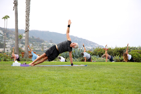 Carl Brown leading a free yoga class in the public park at the Montage resort.