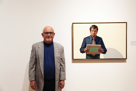 Local resident and art historian Gene Cooper with his portrait by Wayne Thiebaud, part of the museum's just opened exhibition.