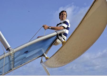 A young Hobie Alter on board a Hobie catamaran sailboat.