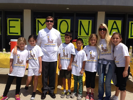 Students put the squeeze on Principal Chris Duddy to participate in last year's stand.