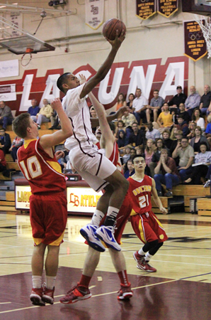 Noah Blanton glides to the hoop for two of his 12 points during Laguna's second round CIF win at home against Whittier Christian on Friday, Feb. 21.